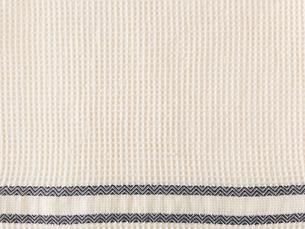 ベージュのワッフル織りの青いラインの布の写真素材 [FYI01603738]
