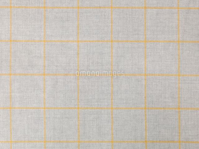 グレーと黄色のウールのチェックの布の写真素材 [FYI01604326]