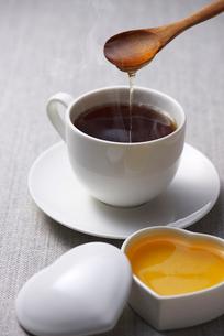 コーヒーに蜂蜜の写真素材 [FYI01609707]