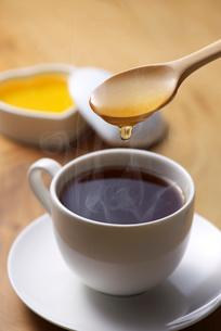 コーヒーに蜂蜜の写真素材 [FYI01609720]