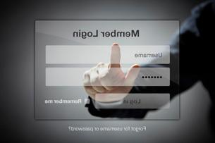 最新テクノロジーを駆使してログインする男性の写真素材 [FYI01638184]