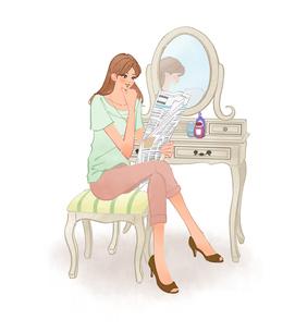 ドレッサーの鏡の前に座り新聞を読む女性のイラスト素材 [FYI01639801]
