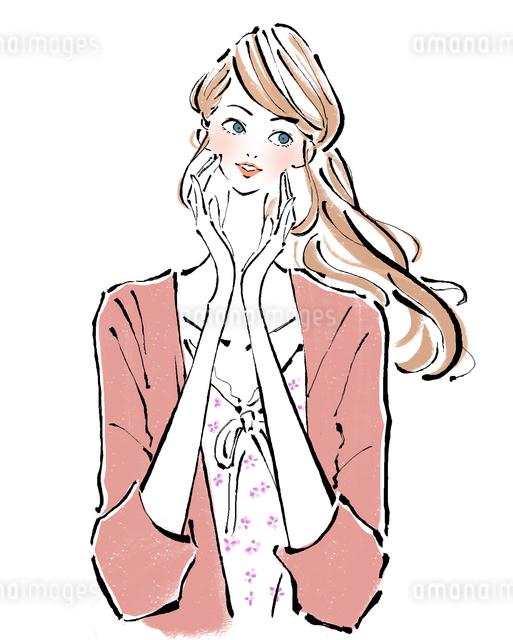 化粧水を肌になじませる女性のイラスト素材 [FYI01639897]