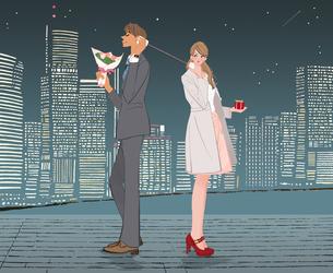 バレンタインに糸電話で話すプレゼントと花束を持ったカップルのイラスト素材 [FYI01639928]