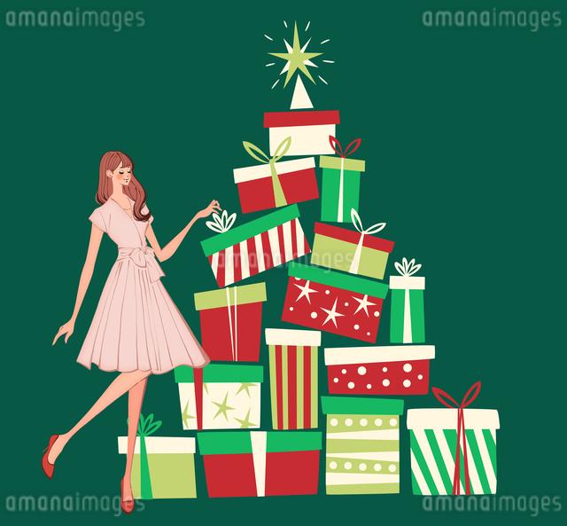 たくさんのクリスマスプレゼントから選ぶ女性のイラスト素材 [FYI01640107]