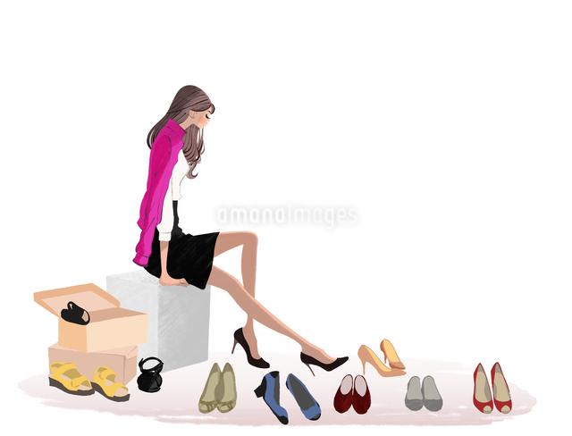 椅子に座り靴を選ぶ女の子のイラスト素材 [FYI01640156]