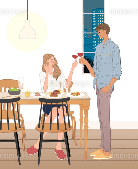 リビングで食事するカップルのイラスト素材 [FYI01640247]