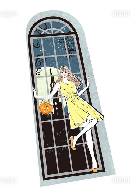 窓辺に立つハロウィンの女性のイラスト素材 [FYI01640260]