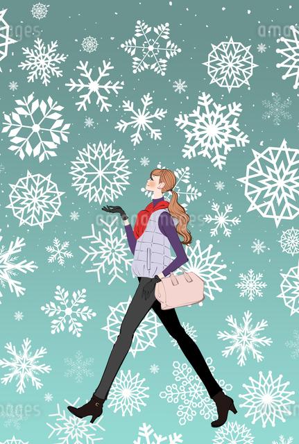 雪の中を歩くマフラーをした女の子のイラスト素材 [FYI01640422]