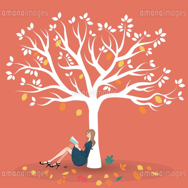 大きな木の下に座り読書する女性のイラスト素材 [FYI01640706]