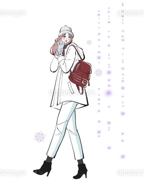 雪を見ながら歩く帽子と手袋をつけた女性のイラスト素材 [FYI01640775]