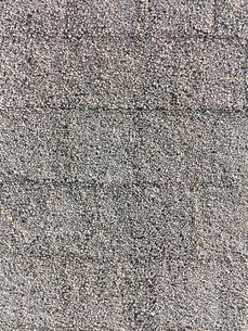 砂利を埋め込んだコンクリートの壁面の写真素材 [FYI01682875]