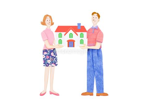 夫婦と住宅の写真素材 [FYI01789714]