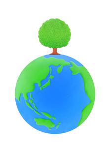 芝生の地球と大樹の写真素材 [FYI01789956]