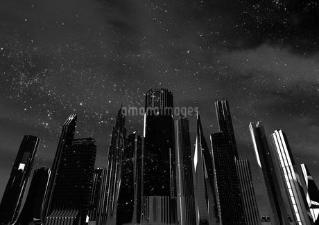 ビルと夜空に降る雪のイラスト素材 [FYI01816645]