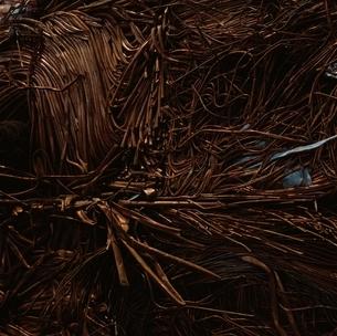 銅線・銅管の圧縮スクラップの写真素材 [FYI01828247]