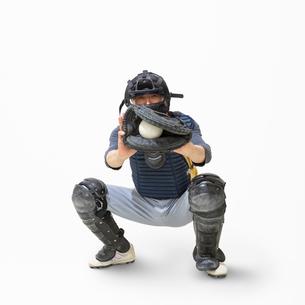 野球のキャッチャーをするシニア男性の写真素材 [FYI01907373]