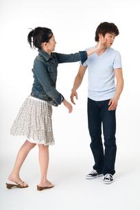 彼を叩く彼女の写真素材 [FYI01932442]