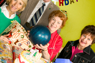 Woman holding ball as birthday presentの写真素材 [FYI01981267]
