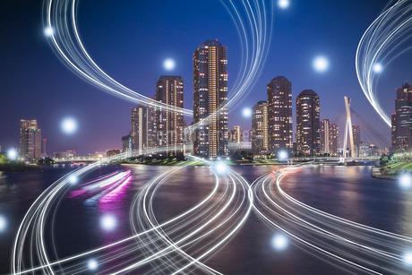 東京の高層ビル群と光のネットワーク 合成の写真素材 [FYI01982519]