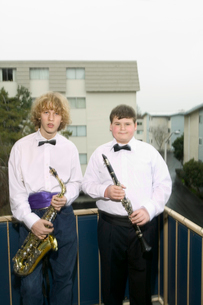 Boys holding musical instrumentsの写真素材 [FYI01983322]