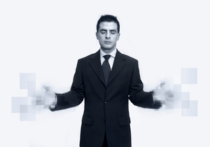 Businessman with blurred-out handsの写真素材 [FYI01985855]