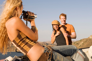 Young woman video taping friendsの写真素材 [FYI01986627]