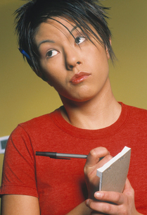 Asian waitress writing food orderの写真素材 [FYI01987263]