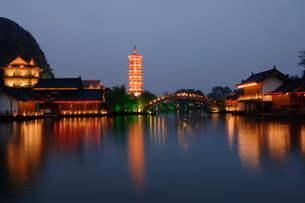 Reflection of pagoda in lake at nightの写真素材 [FYI01987730]