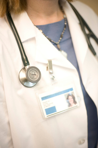 doctor wearing stethoscope and ID cardの写真素材 [FYI01988567]