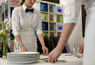 Food servers with silverware at tableの写真素材 [FYI01988827]