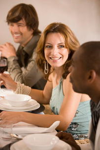 Woman sitting at dinner tableの写真素材 [FYI01989220]