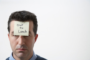 Man wearing Out to Lunch stickerの写真素材 [FYI01989565]