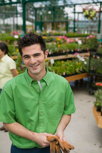 Man smiling at plant nurseryの写真素材 [FYI01989687]