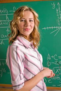 Math teacher by blackboardの写真素材 [FYI01989950]