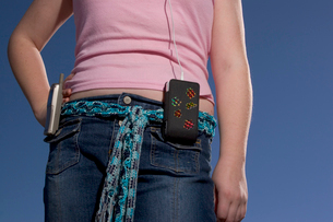 girl with cell phone and mp3 playerの写真素材 [FYI01989991]