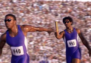 Male athletes passing the batonの写真素材 [FYI01990877]
