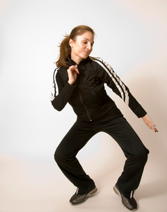 Woman in fitness outfit stretchingの写真素材 [FYI01991123]