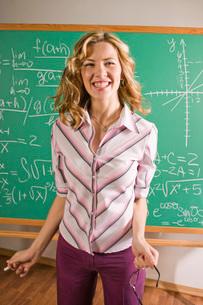 Math teacher by blackboardの写真素材 [FYI01991413]