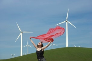 Woman with scarf in front of windmillsの写真素材 [FYI01991463]