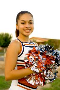 cheerleading girl in uniform and pompomsの写真素材 [FYI01992194]