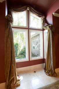 Large Window with Ornate Curtainsの写真素材 [FYI01992481]