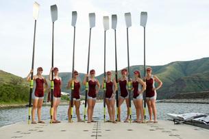 Rowing team holding oars on dockの写真素材 [FYI01992858]