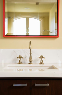 Contemporary Vanity with Red Mirrorの写真素材 [FYI01993891]