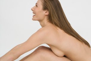 nude woman leaning over her kneesの写真素材 [FYI01994413]