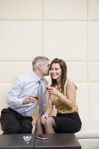 Man telling wife secretの写真素材 [FYI01994646]