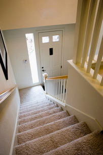 View Down Staircase to Front Doorの写真素材 [FYI01995303]
