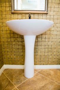 Pedestal Sink in Rustic Tiled Bathroomの写真素材 [FYI01995919]