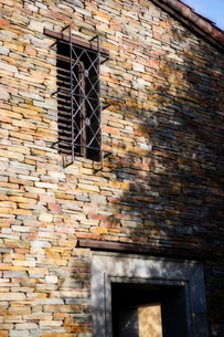 Colorful Stone Buliding with Wraught Iron Windowの写真素材 [FYI01996449]