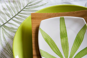 Detail of Place Setting with Green Leavesの写真素材 [FYI01996494]